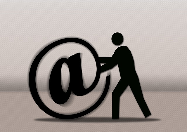 Figure pushing large email at sign