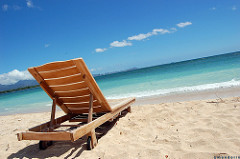Wooden lounger on beach